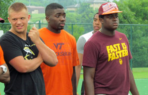 Billy Ray Mitchell (left), XavierBurke, and Tyrell Smith (right) at Tech in the summer of 2013