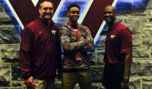 Reynolds shown here with VT coaches Foster and Gray (photo courtesy of Reynolds)