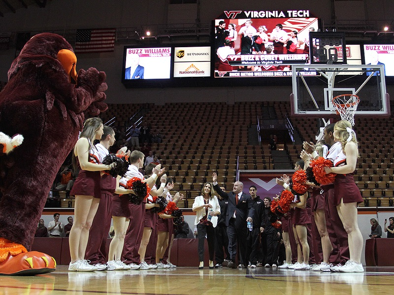 Buzz Williams and wife Corey entered Cassell to loud applause.