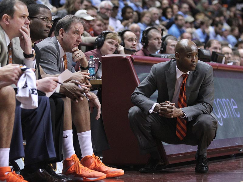 James Johnson and his assistants watch the action during Virginia Tech's 60-56 home loss to UNC on March 1st, 2014.