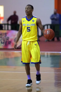 Robinson, who played for Boo Williams on the AAU circuit, surveys the court at the 2014 Nike EYBL in Hampton