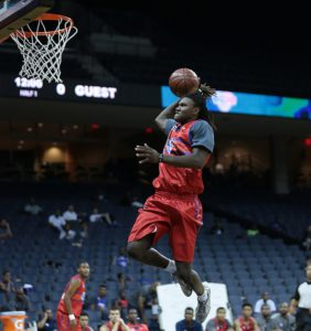 Clarke, shown here soaring at the 2014 NBA Top 100 camp in Charlottesville, has displayed his versatile for Cape Henry this season.