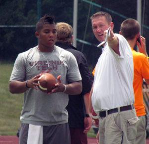 Loeffler gives McIlwain some pointers during VT's July 14 Camp