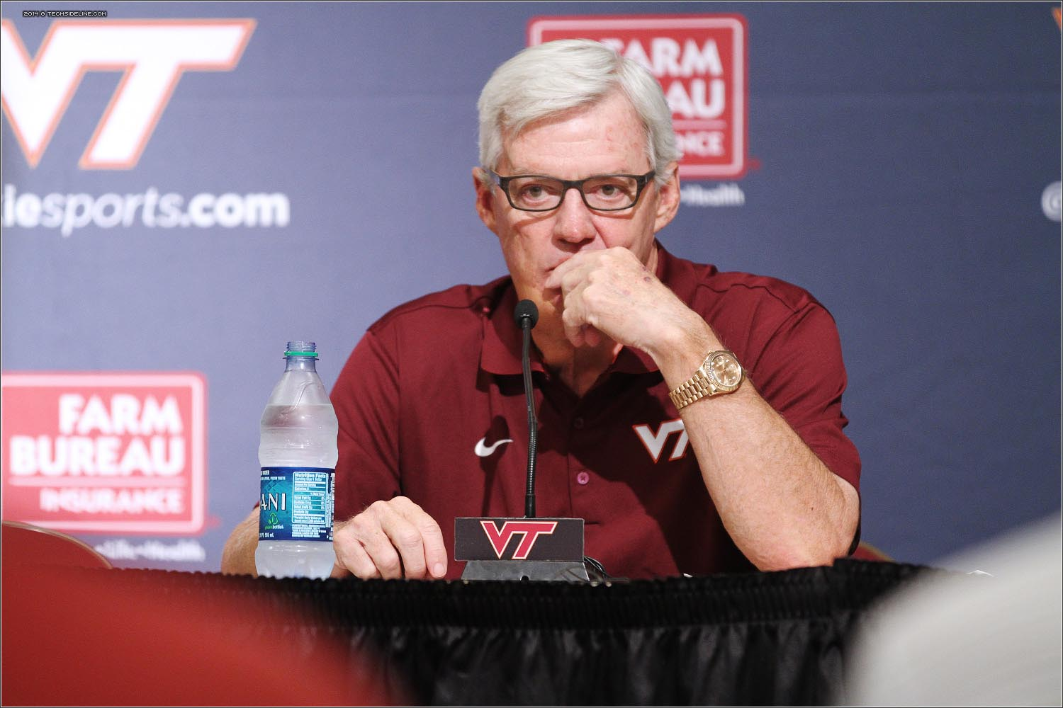 Frank Beamer listens to a question during 2014 Football Media day on Saturday, August 9.