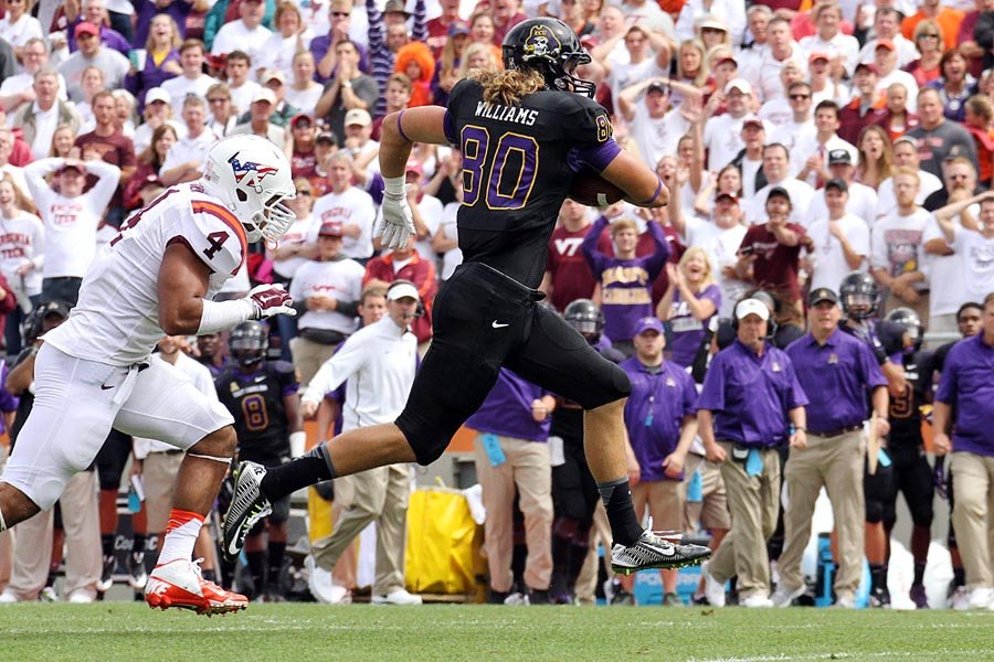 ECU's Bryce Williams races towards a first down after catching a tipped pass.