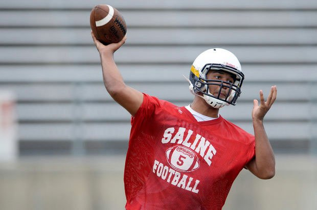 Jackson, throwing a pass in the preseason of his junior year (Photo from Saline Football)