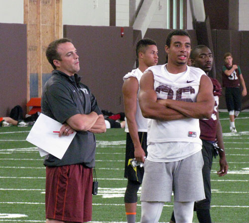Primary recruiter Shane Beamer speaking with Lawler during VT's camp on June 14