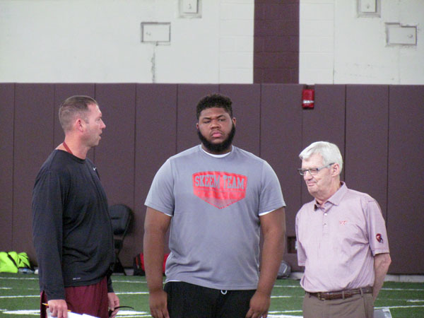 Valentin, shown here speaking with VT coaches Scot Loeffler and Frank Beamer