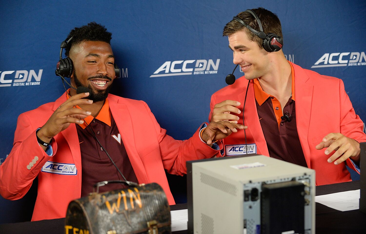 Kendall Fuller and Michael Brewer have a little fun during ACC Football Kickoff 2015.