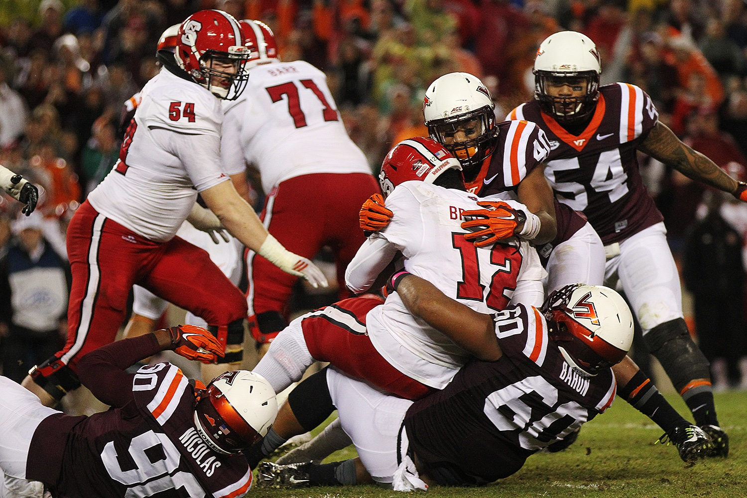 Woody Baron (#60) and the Hokies got after Jacoby Brissett, sacking him four times.