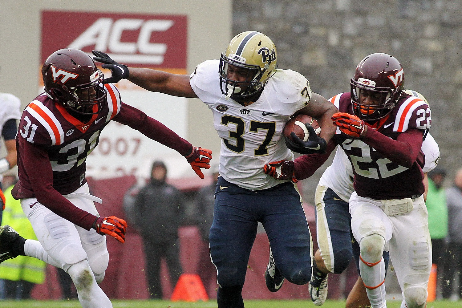 Pitt's Qadree Ollison rumbles for yardage.
