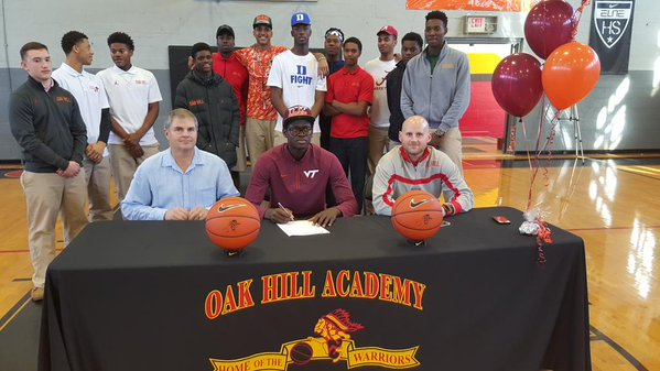 Sy, shown here signing his letter of intent.  Photo courtesy of Oak Hill Academy head coach Steve Smith.
