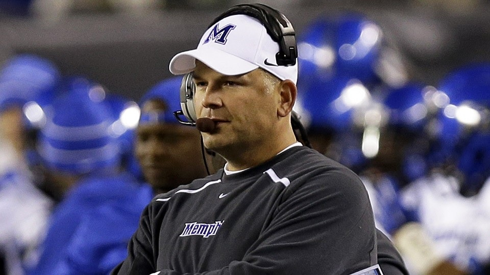 Justin Fuente, shown in Memphis gear that he won't be wearing anymore (AP Photo).