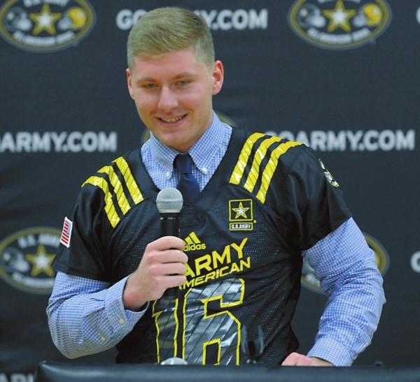 Photo of Long accepting his U.S. Army All-American Bowl nomination.  Photo by Wayne Hinshaw (Salisbury Post)