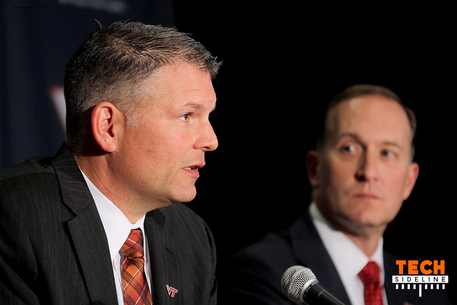 Justin Fuente, with Whit Babcock looking on