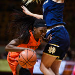 Chanette Hicks (12), pushes past Notre Dame in Cassell Coliseum Feb. 2, 2017.