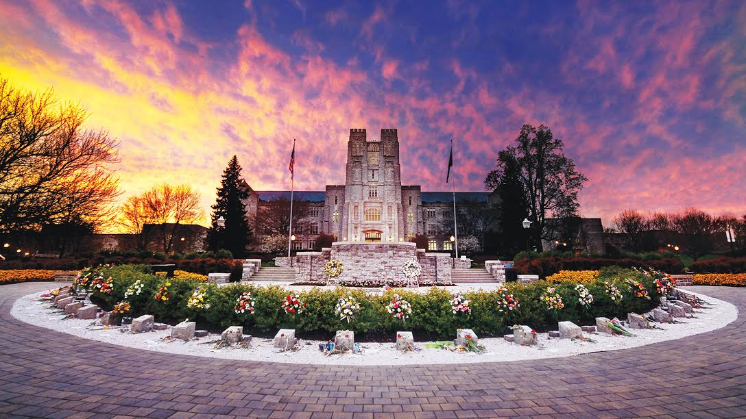 2014.04.19. Sunset behind Burruss Hall and April 16 Memorial. Campus Photography, Virginia Tech.